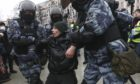 Police detain a man during a protest against the jailing of opposition leader Alexei Navalny in Moscow, Russia, Saturday, Jan. 23, 2021.