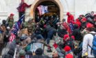 Rioters clash with police trying to enter Capitol building through the front doors