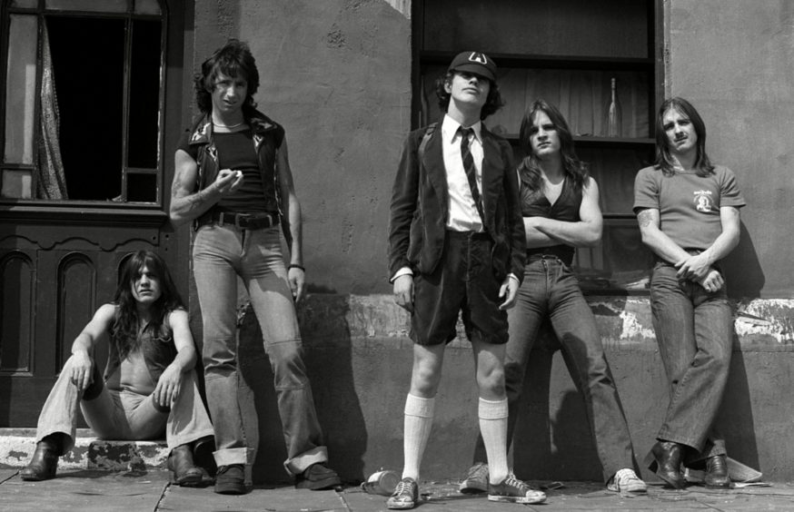 Malcolm Young, Bon Scott, Angus Young, Mark Evans and Phil Rudd at Pinewood Studios in London
