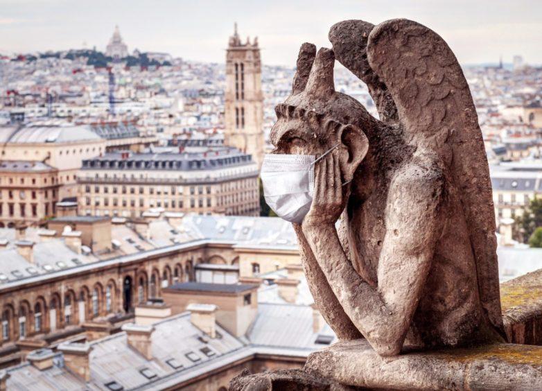 A gargoyle on the Notre Dame de Paris