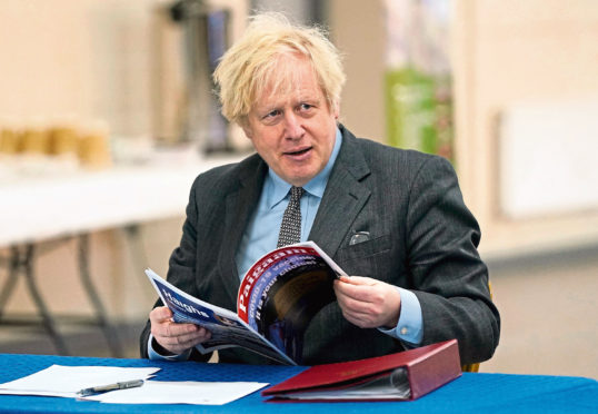 Prime Minister Boris Johnson during  a visit to a coronavirus vaccination centre in Batley, West Yorkshire.