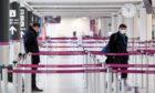 Edinburgh, Scotland's busiest airport, before the enforced quarantine of arrivals begins tomorrow