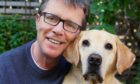 Nicky Campbell with Labrador Maxwell who helped the TV and radio presenter deal with his feelings of abandonment