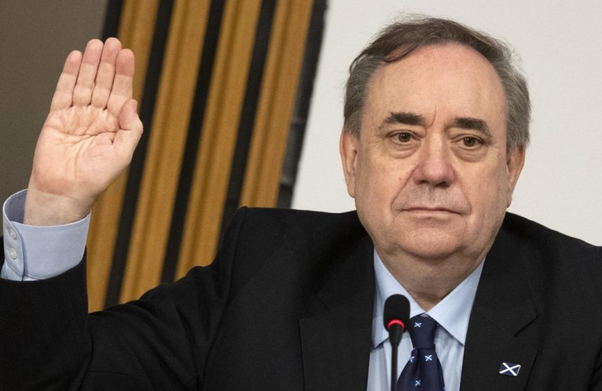 Former first minister Alex Salmond is sworn in before giving evidence to the committee
