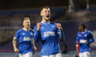 Borna Barisic celebrates after netting from the spot against Royal Antwerp