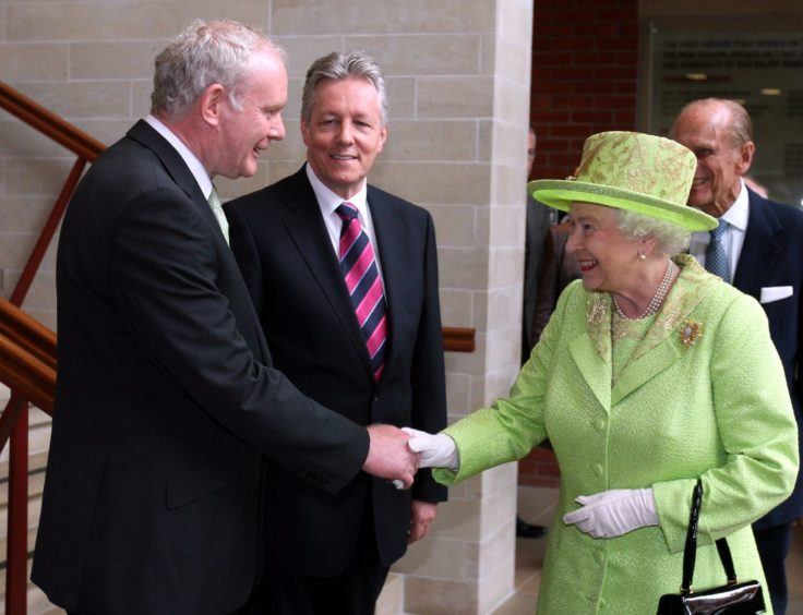 Troubles over: In June 2012, the Queen shakes hands with Martin McGuinness, a leader of the IRA turned Northern Ireland deputy first minister, after peace was brokered in the Good Friday Agreement.