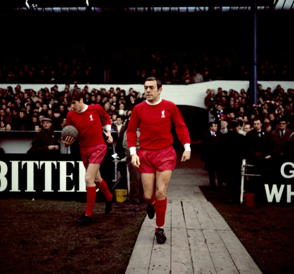 Ian St John making his way onto the pitch for Liverpool