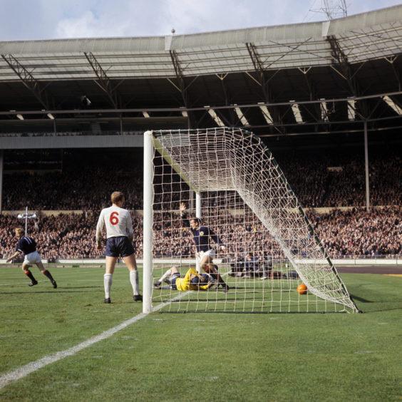 Scotland's Ian St John celebrates scoring against England at Wembley