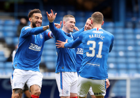 Rangers' win against St Mirren yesterday meant Celtic had to win at Tannadice to delay their rivals' celebrations