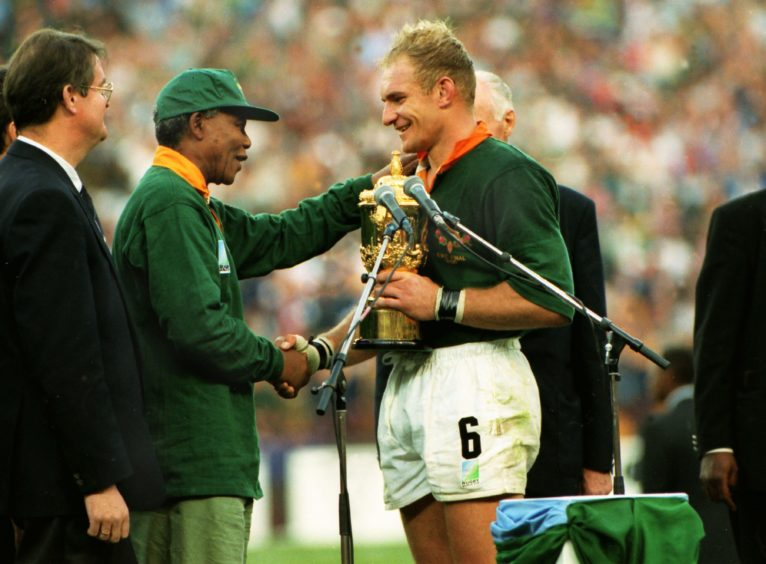 One nation: President Nelson Mandela congratulates captain François Pienaar after South Africa win the Rugby World Cup in June 1995. A symbolic moment of unity after the recent end of apartheid.