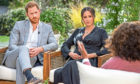 The Duke and Duchess of Sussex in discussion with Oprah Winfrey.