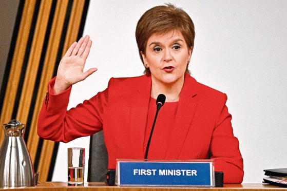 First Minister Nicola Sturgeon taking oath before giving evidence to the committee