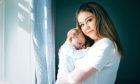Megan Collins, with her newborn baby boy, Carson.