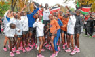 Eliud Kipchoge celebrates breaking the two hour barrier for a marathon distance with supporters and his team on the Hauptallee.
