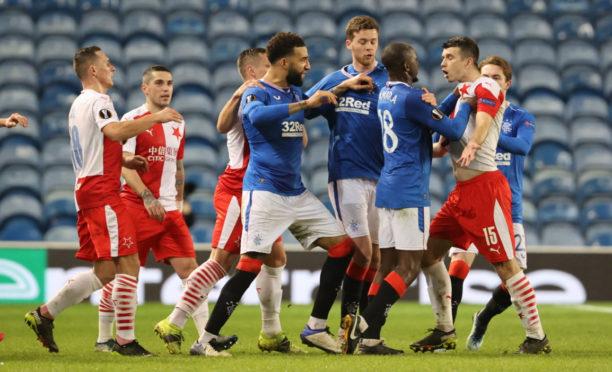 Glen Kamara, backed up by                         Connor Goldson, takes issue with Slavia Prague defender, Ondrej Kudela, at Ibrox last Thursday night.
