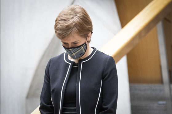 First Minister Nicola Sturgeon observes a minute's silence during the National Day of Reflection