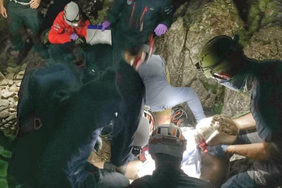 Rescue team fight on the mountainside to save Dan after he falls more than 80ft