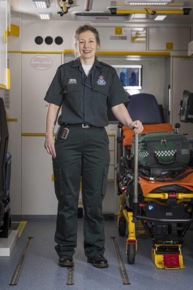 Gina on board an ambulance