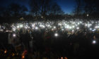 People use their phones to light up Clapham Common, London last night as part of an unofficial vigil for murder victim Sarah Everard
