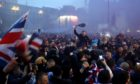 Fans celebrate in Glasgow's George Square last Sunday after Rangers win the Scottish Premiership