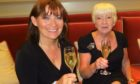 Lorraine enjoys a glass of fizz with mum Anne