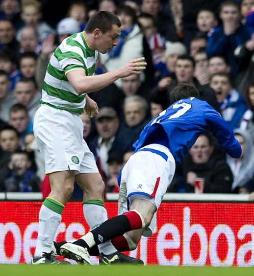 2010 – Scott Brown was sent off after this clash with Kyle Lafferty