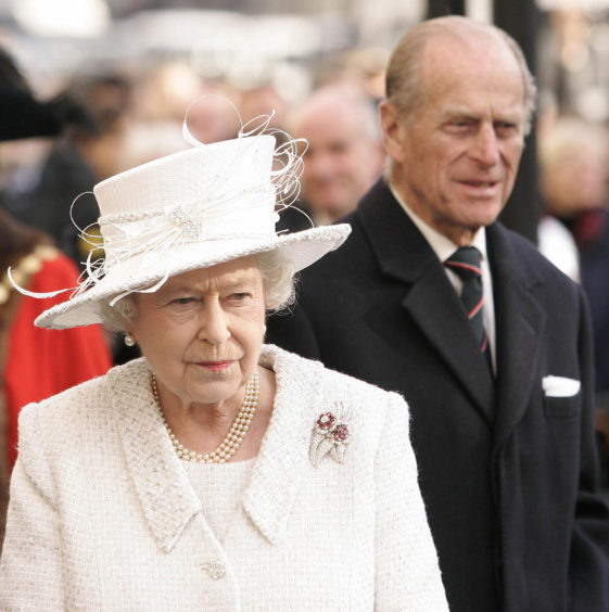 Queen Elizabeth II and The Duke of Edinburgh unveiling a Jubilee Walkway panoramic panel on Parliament Square in London.
