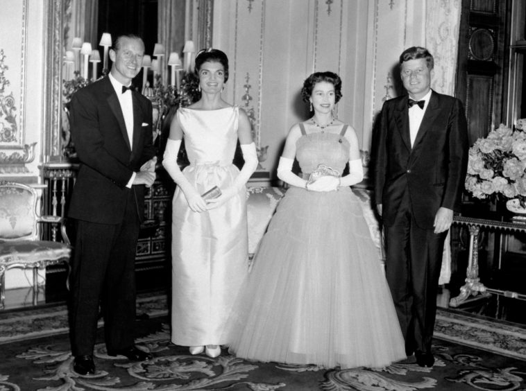 American President John Kennedy (right) and his wife Jacqueline (second left) pictured with Queen Elizabeth II (second right) and the Duke of Edinburgh at Buckingham Palace, in London.
