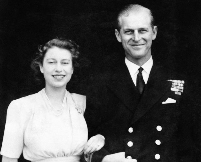The then Princess Elizabeth and Lieutenant Philip Mountbatten posing for their first engagement pictures at Buckingham Palace.