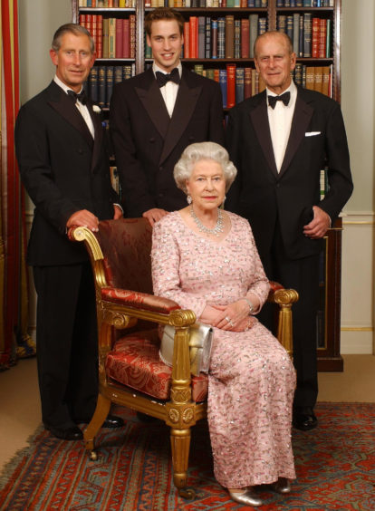 Three generations of the British Royal family - Queen Elizabeth II and her husband, the Duke of Edinburgh, their oldest son, the Prince of Wales, and his oldest son, Prince William - posing for a photograph at Clarence House in London before a dinner to mark the 50th anniversary of her Coronation.
