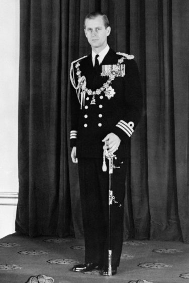 The Duke of Edinburgh, in the Throne Room of Buckingham Palace in London after he and the Queen had returned from her first State Opening of Parliament.