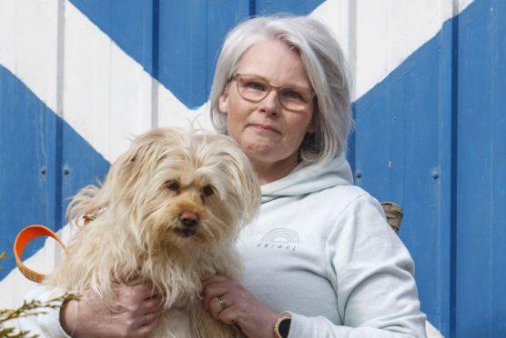 Anne Stewart at home in Macduff with pet terrier Shyla