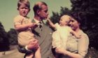 The Queen and Duke of Edinburgh with Charles and baby Anne in the grounds of Clarence House, London, on August 9, 1951