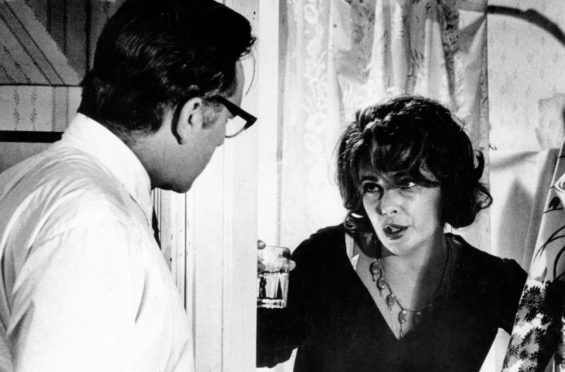 Richard Burton and Elizabeth Taylor row while famously playing a couple in turmoil in 1966 movie Who's Afraid Of Virginia Woolf?