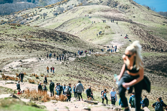 Crowds of people climbing up to the summit of Conic Hill on Loch Lomnd, as lockdown restrictions are eased and people are now allowed to leave their local areas.