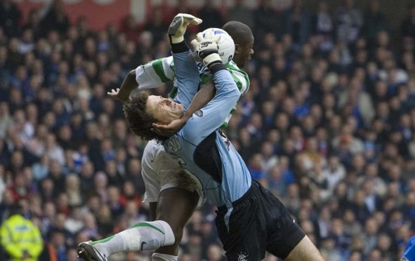 Ronald Waterreus claims this cross, despite the formidable presence of Bobo Balde, during an Old Firm game in 2006