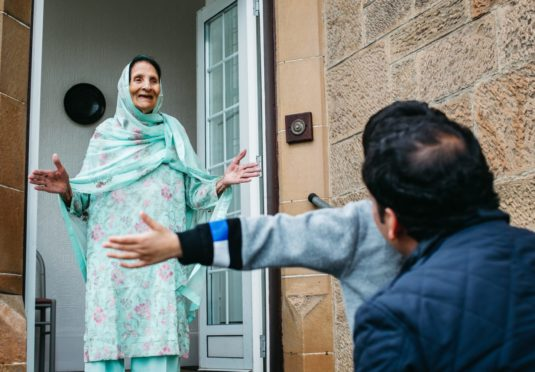 Anas Sarwar, with his son, Aliyan (4), visiting his grandmother, Rashida Begum (93), at her home in Glasgow. Rashida has been shielding due to her age, during lockdown, so was very happy to have them visiting.