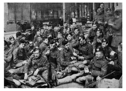 The soldiers of the London Scottish in their Hodden Grey at a French station in 1914