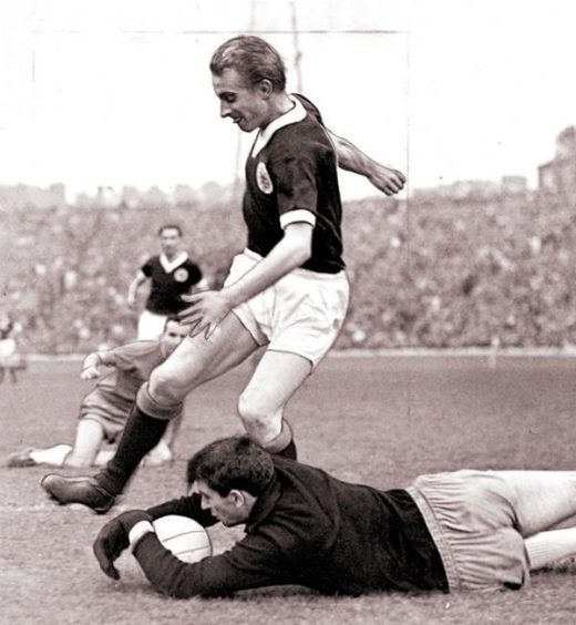 Denis Law playing for Scotland, 1965.