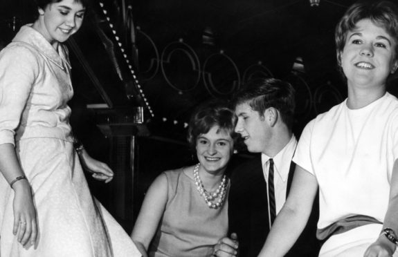 Teenage twisters Janet Mitchell, on left, and friends Maureen McGilvray and Sandra Stroyan dance at the reopening of the Locarno dancehall, in Glasgow, in September 1962