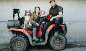 Emma Gray with her husband Ewan Irvine and son Len, aged two, on their farm on the Isle of Bute.