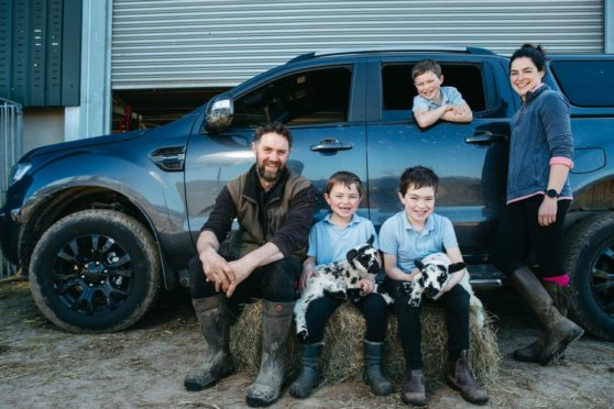 Kieran and Linda McCullough with children, left to right, Rory, six, Lewis, nine, and Blair, eight, with their Ford Ranger at the family farm in Achnamara, Argyll