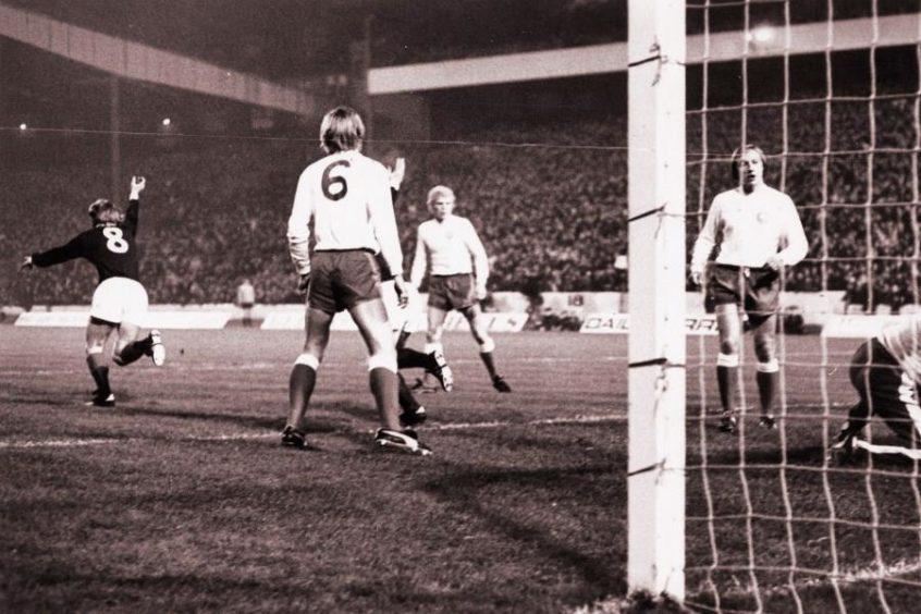 Kenny Dalgish turns and starts celebrating after scoring. Scotland v Denmark, 1972.