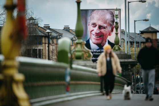 An image of the Duke of Edinburgh is displayed on an electronic billboard in Glasgow city centre yesterday