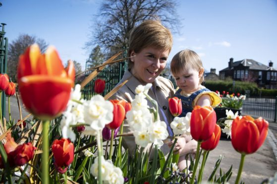 Nicola Sturgeon with Alisa Innes, the daughter of SNP candidate Natalie Don, on the campaign trail in Renfrew