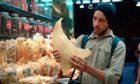 Ali Tabrizi (Filmmaker and avid ocean-lover) handles a shark fin in Seaspiracy.