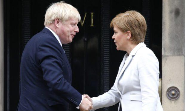 Boris Johnson shakes hands with Nicola Sturgeon outside Bute House in 2019