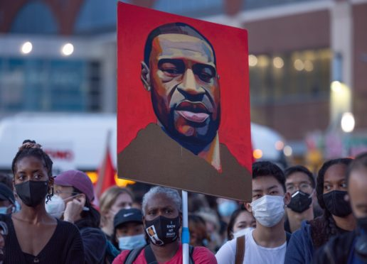 Demonstrators gather outside the Barclays Center in New York after Derek Chauvin's conviction