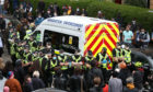 Police by an immigration van in Kenmure Street, Glasgow which is surrounded by protesters