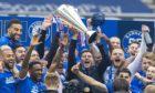 Steven Gerrard and his Rangers team lift the league trophy